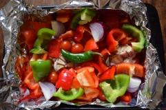 Red peppers, onions, chilli, tomato and garlic, ready to roast